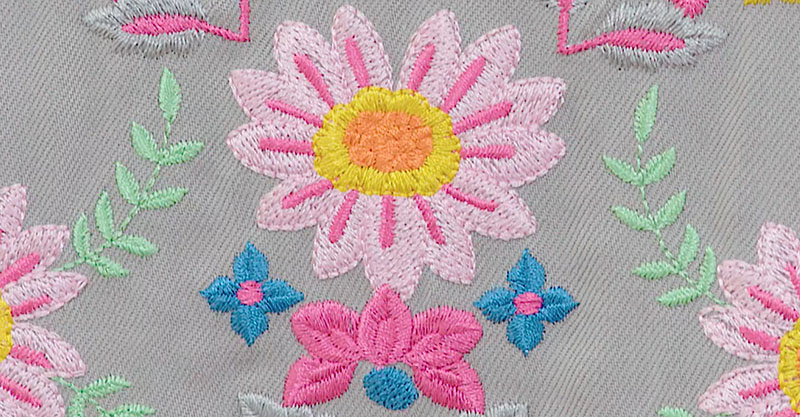 Floral embroidery on a grey fabric