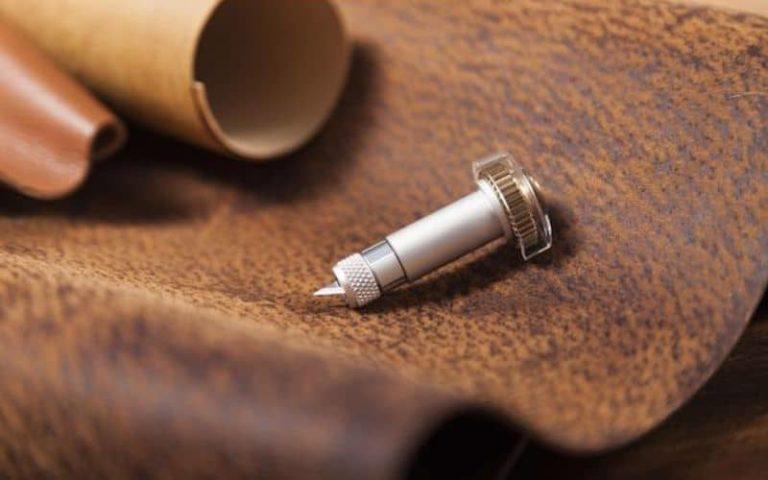 Cricut blade on a piece of fabric