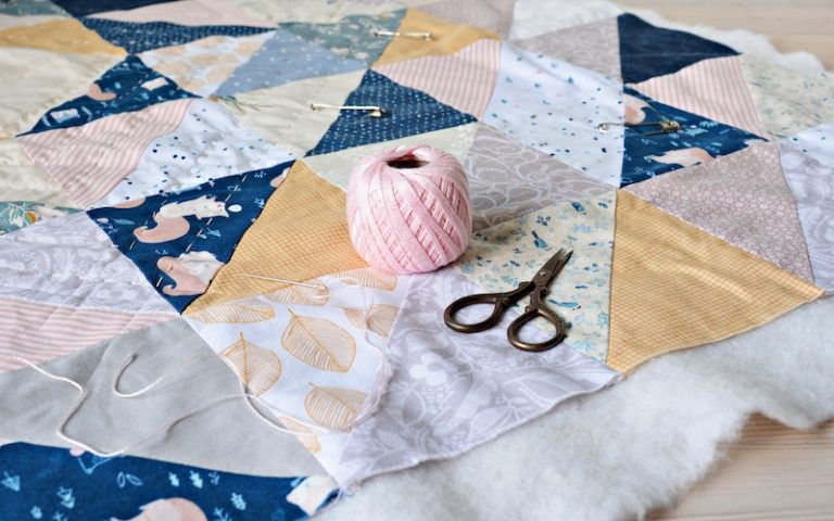 the process of sewing blanket with an easy quilt pattern