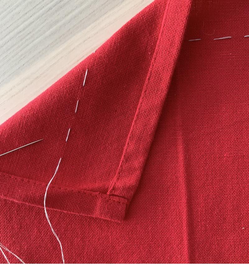 a stitch sewn by hand