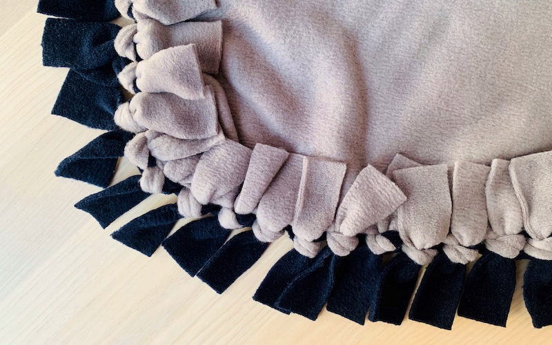 no sew fleece blanket on a wooden table
