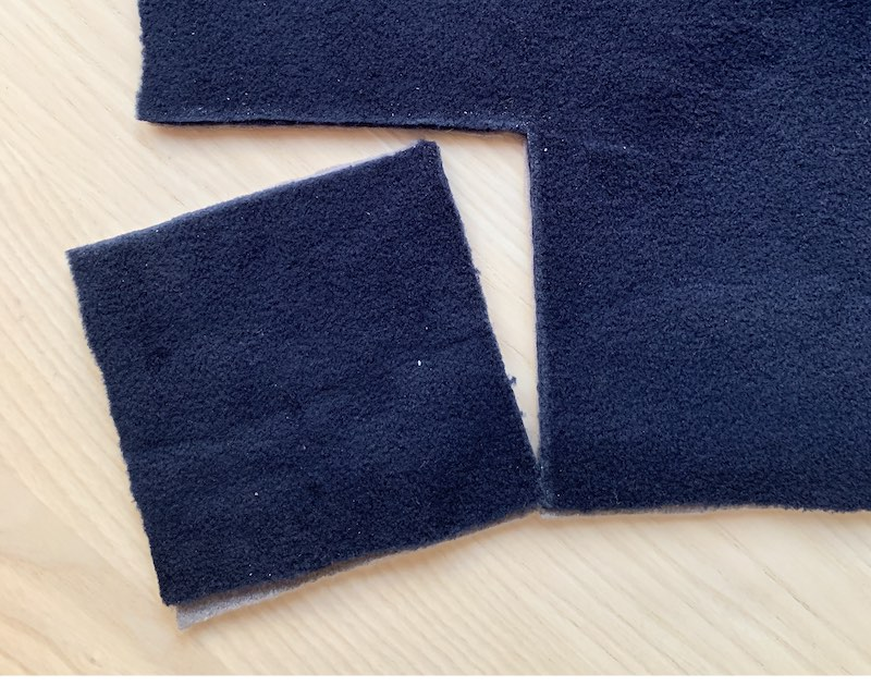 fleece fabric with a square piece cut out