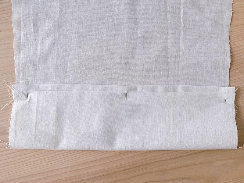 a white piece of fabric folded along the hemline