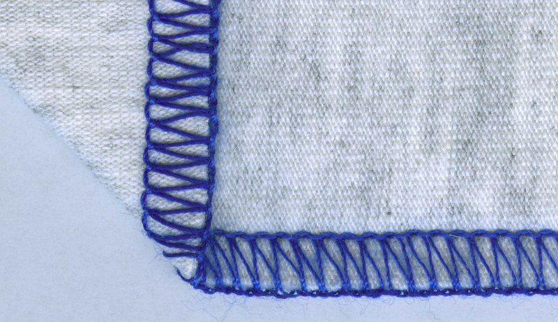 overlock stitch on a grey fabric