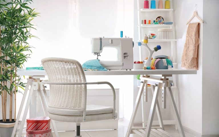 sewing machine with fabric on table in a sewing room
