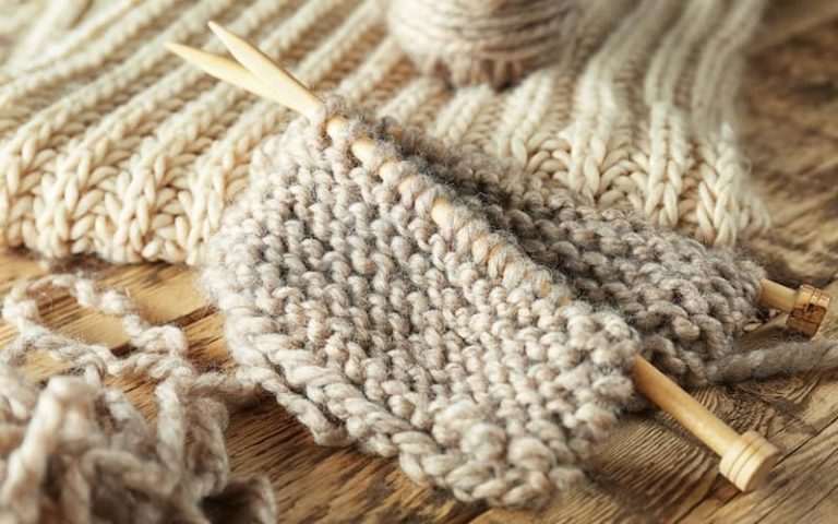 knitting stitches on a pair of knitting needles