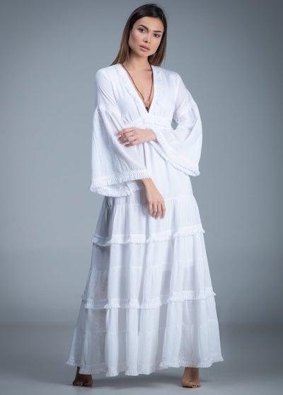 woman wearing a white boho dress