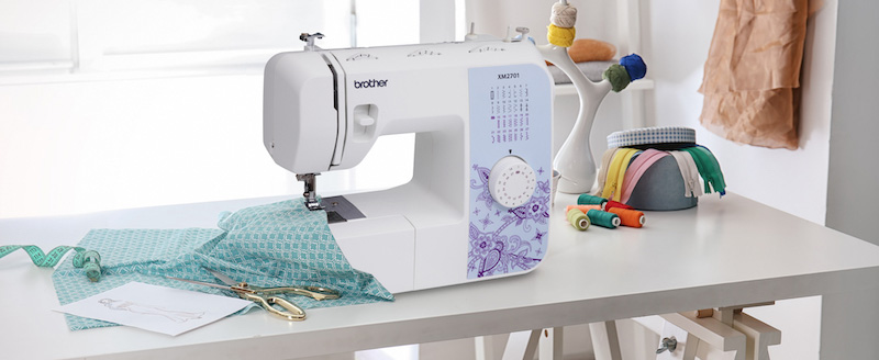 Brother XM2701 sewing machine on a table