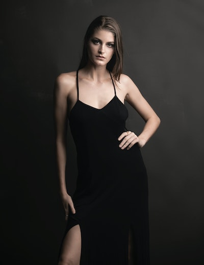 woman wearing a black camisole dress