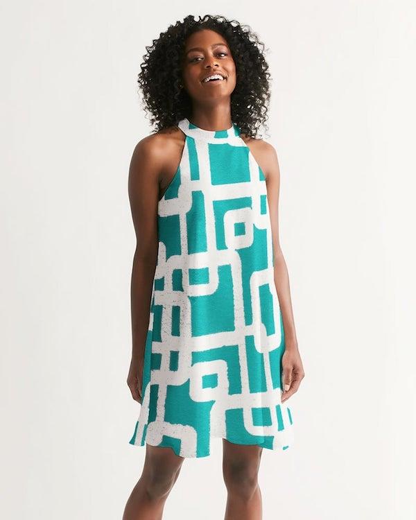 woman wearing a halter neck dress