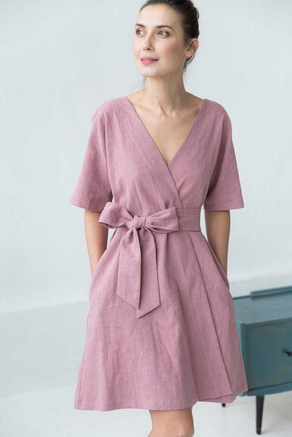 woman wearing a pink kimono dress