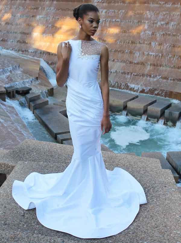 woman wearing a white mermaid's tail dress