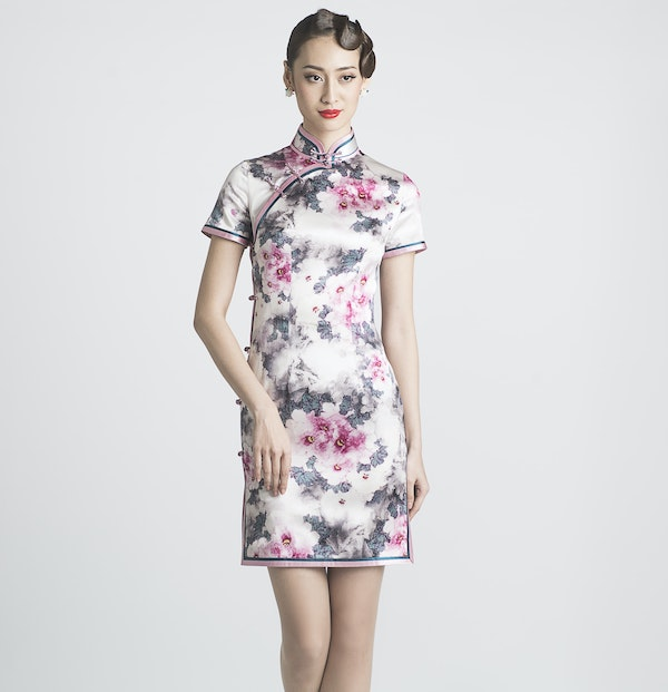 woman wearing a floral printed qipao dress