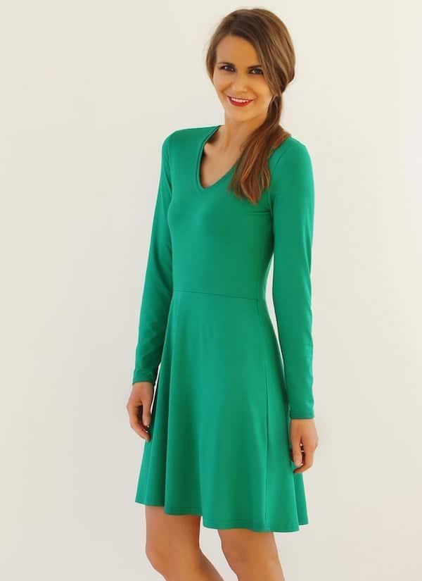 woman wearing a green skater dress