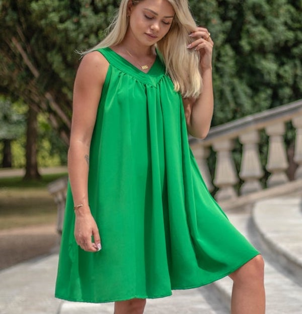 woman wearing a green yoke dress