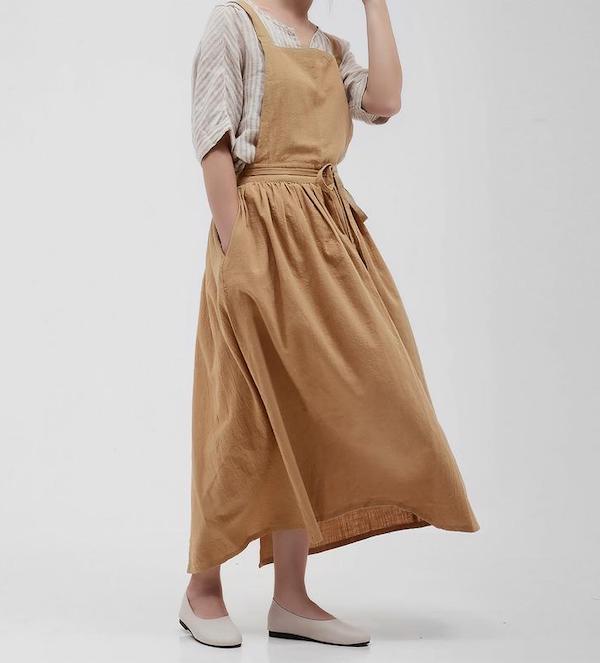 woman wearing a yellow apron dress