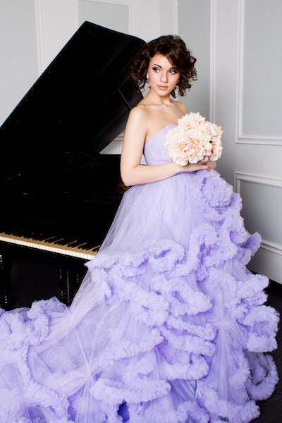 woman wearing lilac ballgown