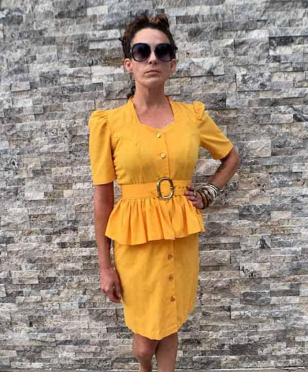 woman wearing a yellow peplum dress